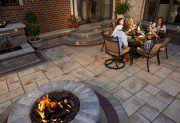 Rivenstone paver patio with fireplace by Unilock