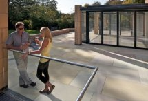 Modern Patio with Natural Stone by Unilock
